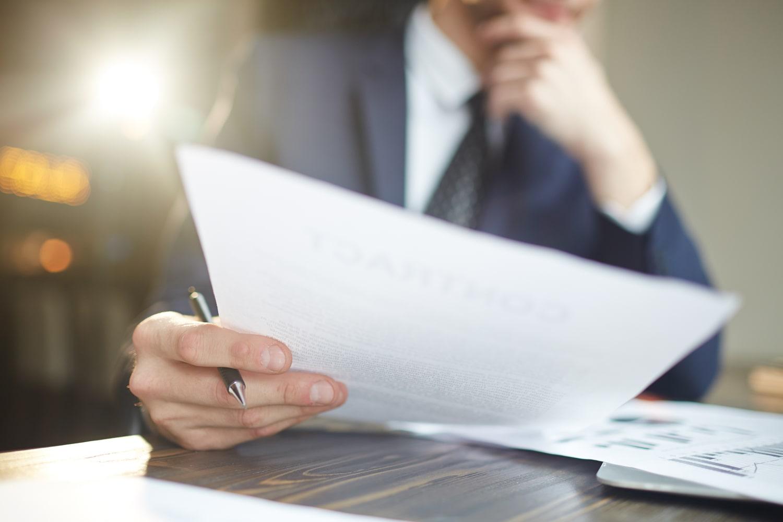 man reviewing business docs