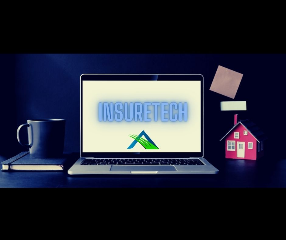 insurance agent office table with laptop, planner, mug, and small model of house