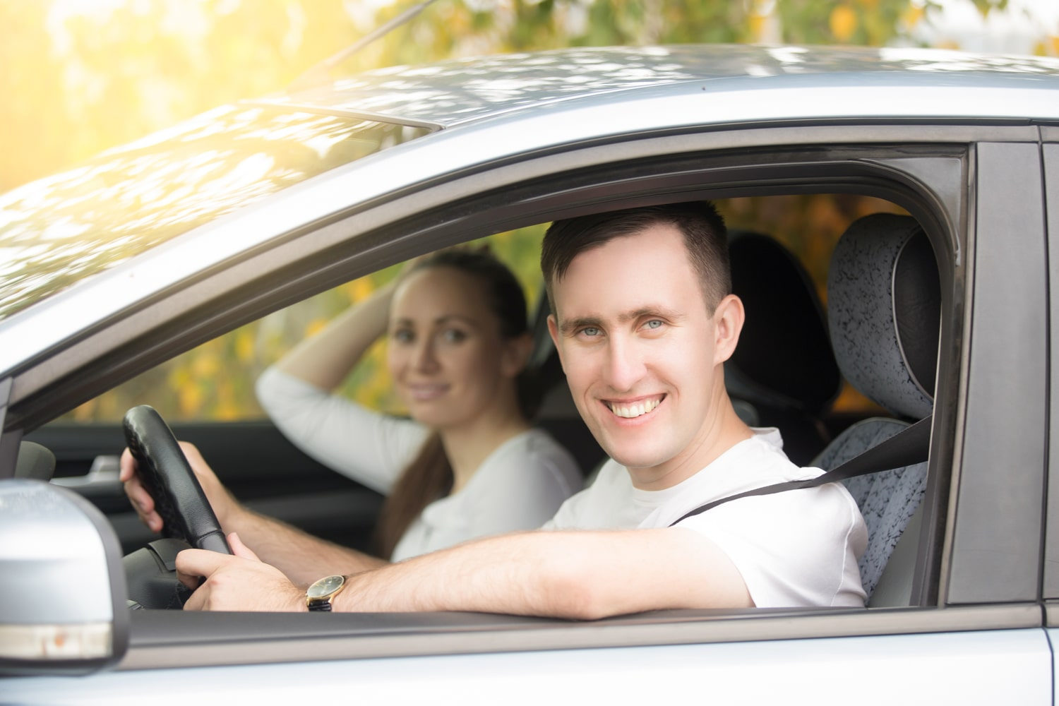 Driver smiling with passenger